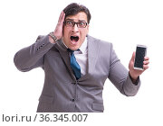 Businessman with mobile phone isolated on white. Стоковое фото, фотограф Elnur / Фотобанк Лори