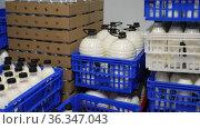 Image of crates of fresh farm cow's milk spilled in plastic bottles. Стоковое видео, видеограф Яков Филимонов / Фотобанк Лори