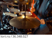 Brutal musician behind the drum kit on stage. Стоковое фото, фотограф Tryapitsyn Sergiy / Фотобанк Лори