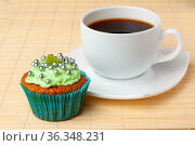 Cup of coffee and cupcake with cream and decorative toppings. Стоковое фото, фотограф Анна Гучек / Фотобанк Лори