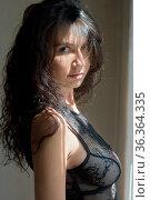 Portrait of the sexy beautiful woman with long curl hair in black... Стоковое фото, фотограф Zoonar.com/© Dmitry Raikin / easy Fotostock / Фотобанк Лори
