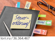 The german word Steuererklärung (Tax return) on a sticky note. Стоковое фото, фотограф Zoonar.com/Boris Zerwann / easy Fotostock / Фотобанк Лори