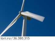 Close-up of a wind turbine turning at full power, under a completely... Стоковое фото, фотограф Marquicio Pagola / age Fotostock / Фотобанк Лори