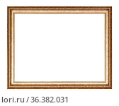 Empty golden carved wooden picture frame with cut out canvas isolated... Стоковое фото, фотограф Zoonar.com/Valery Voennyy / easy Fotostock / Фотобанк Лори