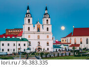 Moonrise over Cathedral Of Holy Spirit In Minsk. Famous and Main Orthodox... Стоковое фото, фотограф Ryhor Bruyeu / easy Fotostock / Фотобанк Лори