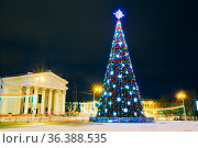 Main Christmas Tree And Festive Illumination On Lenin Square In Gomel... Стоковое фото, фотограф Ryhor Bruyeu / easy Fotostock / Фотобанк Лори