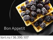 Belgian waffles with frozen blackberries on a black background, inscription... Стоковое фото, фотограф Zoonar.com/Sergiy Artsaba / easy Fotostock / Фотобанк Лори