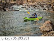 Senior male kayaker is paddling an inflatable whitewater kayak on... Стоковое фото, фотограф Zoonar.com/Marek Uliasz / easy Fotostock / Фотобанк Лори
