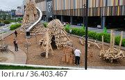 Yekaterinburg, Russia-July 26 2021: Fathers walk with children on playground of eco materials. Редакционное видео, видеограф Ekaterina Demidova / Фотобанк Лори