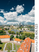 Vilnius, Lithuania. Modern City And Part Of Old Town Under Dramatic... Стоковое фото, фотограф Ryhor Bruyeu / easy Fotostock / Фотобанк Лори
