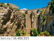 The New Bridge (Puente Nuevo) is the 120-metre (390 ft)-deep chasm... Стоковое фото, фотограф Ryhor Bruyeu / easy Fotostock / Фотобанк Лори