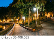 Gomel, Homiel, Belarus. Lighted Walkways Or Roads, Greenwood At Blue... Стоковое фото, фотограф Ryhor Bruyeu / easy Fotostock / Фотобанк Лори