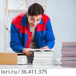 Worker in publishing house preparing book order. Стоковое фото, фотограф Elnur / Фотобанк Лори