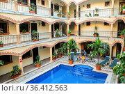 Interior of a hotel at Playa del Carmen in Quinata Roo province. ... (2011 год). Редакционное фото, фотограф Marquicio Pagola / age Fotostock / Фотобанк Лори