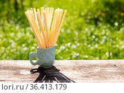 Biodegradable compostable natural straws, made from cane. Zero waste... Стоковое фото, фотограф Zoonar.com/OKSANA SHUFRYCH / easy Fotostock / Фотобанк Лори