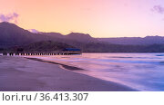 Sunrise lights the dawn sky above Hanalei Pier with the Na Pali coast... Стоковое фото, фотограф Zoonar.com/Steve Heap / easy Fotostock / Фотобанк Лори