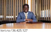 Portrait of friendly businessman at negotiation table in office. Стоковое фото, фотограф Яков Филимонов / Фотобанк Лори