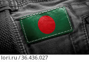 Tag on dark clothing in the form of the flag of the Bangladesh. Стоковое фото, фотограф Zoonar.com/BUTENKOV ALEKSEY / easy Fotostock / Фотобанк Лори