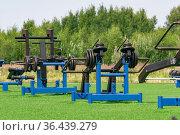 Public exercise machines for outdoor weight training. Стоковое фото, фотограф Евгений Харитонов / Фотобанк Лори