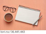 Workspace flat lay with blank spiral notebook, pen, tea and reading... Стоковое фото, фотограф Zoonar.com/Marek Uliasz / easy Fotostock / Фотобанк Лори