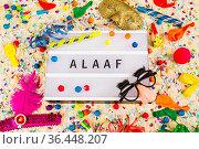 Lichtbox mit Buchstaben - Alaaf - mit Konfetti und Partyartikeln. Стоковое фото, фотограф Zoonar.com/Birgit Reitz-Hofmann / easy Fotostock / Фотобанк Лори