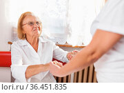 Providing care and support for elderly. Стоковое фото, фотограф Zoonar.com/Tomas Anderson / easy Fotostock / Фотобанк Лори