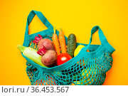 Fresh organic vegetables in cotton bag, lay on the yellow background... Стоковое фото, фотограф Zoonar.com/Oksana Shufrych / easy Fotostock / Фотобанк Лори