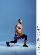 Male athlete with dumbbells, training in studio. Стоковое фото, фотограф Tryapitsyn Sergiy / Фотобанк Лори