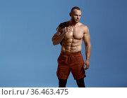 Strong male athlete, photo shoot in studio. Стоковое фото, фотограф Tryapitsyn Sergiy / Фотобанк Лори