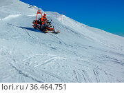 Empty ski slope in sunny weather. Mountain rescue on a snowmobile. Стоковое фото, фотограф Zoonar.com/Mikhail Pavlov / easy Fotostock / Фотобанк Лори