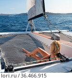 Beautiful woman relaxing on a summer sailing cruise, lying and sunbathing... Стоковое фото, фотограф Zoonar.com/Matej Kastelic / easy Fotostock / Фотобанк Лори