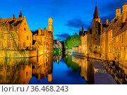 Bruges, Belgium - April 17, 2017: View from the Rozenhoedkaai of the... Стоковое фото, фотограф Zoonar.com/Yuri Dmitrienko / easy Fotostock / Фотобанк Лори