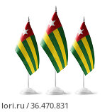 Small national flags of the Togo on a white background. Стоковое фото, фотограф Zoonar.com/BUTENKOV ALEKSEY / easy Fotostock / Фотобанк Лори