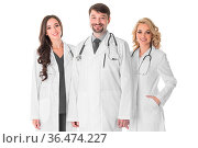 Happy medical team of doctors man and women isolated on white background... Стоковое фото, фотограф Zoonar.com/Ivan Mikhaylov / easy Fotostock / Фотобанк Лори