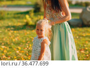 Portrait of happy loving mother and her lttle baby girl at outdoors... Стоковое фото, фотограф Zoonar.com/Max / easy Fotostock / Фотобанк Лори