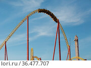 Rollercoaster Ride against blue sky. Roller coaster in the amusement... Стоковое фото, фотограф Zoonar.com/Max / easy Fotostock / Фотобанк Лори