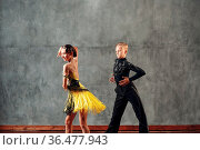 Young couple dancers dancing ballroom dance cha-cha-cha. Стоковое фото, фотограф Zoonar.com/Max / easy Fotostock / Фотобанк Лори