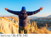 Tourist in famous touristic place Cappadocia, Turkey. Стоковое фото, фотограф Zoonar.com/Galyna Andrushko / easy Fotostock / Фотобанк Лори