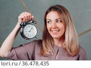 Business woman young adult coach with clock watch at office portrait... Стоковое фото, фотограф Zoonar.com/Max / easy Fotostock / Фотобанк Лори
