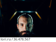 Backlit bearded adult man portrait in dark. Стоковое фото, фотограф Zoonar.com/Max / easy Fotostock / Фотобанк Лори