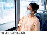 Indian Woman ride in public transport bus or tram in medical face mask. Стоковое фото, фотограф Zoonar.com/Max / easy Fotostock / Фотобанк Лори