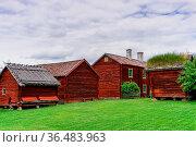 Gamla Uppsala, Sweden - 24 June, 2021: idyllic red cottages in the... Стоковое фото, фотограф Zoonar.com/Nando Lardi / easy Fotostock / Фотобанк Лори