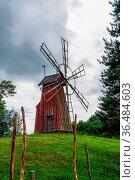 Gamla Uppsala, Sweden - 24 June, 2021: small red wooden windmill on... Стоковое фото, фотограф Zoonar.com/Nando Lardi / easy Fotostock / Фотобанк Лори