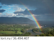 Rainbow over the Newry River (which marks the Eire/UK border) and Warrenpoint from Flagstaff, County Down, Northern Ireland, UK. August 2018. Стоковое фото, фотограф David Noton / Nature Picture Library / Фотобанк Лори