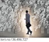 Businessman facing questions in business. Стоковое фото, фотограф Elnur / Фотобанк Лори