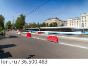Modern tram on a Moscow street, Russia. To obtain a blur effect,an ND2 up to ND400 filter with adjustable neutral density is used. No other changes were made. Редакционное фото, фотограф Владимир Журавлев / Фотобанк Лори