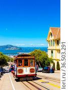 San Francisco, USA - May 15, 2016: Tourists riding outside cable ... Стоковое фото, фотограф Zoonar.com/Pius Lee / age Fotostock / Фотобанк Лори