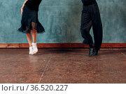 Legs of young couple boy and girl dancing in ballroom dance Jive. Стоковое фото, фотограф Zoonar.com/Max / easy Fotostock / Фотобанк Лори