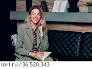 Business woman young adult coach using mobile phone at office. Стоковое фото, фотограф Zoonar.com/Max / easy Fotostock / Фотобанк Лори