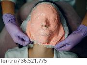 Alginate face mask application process. A female hands of a beautician... Стоковое фото, фотограф Zoonar.com/Max / easy Fotostock / Фотобанк Лори